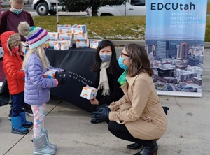 Children accepting a box of face masks outside