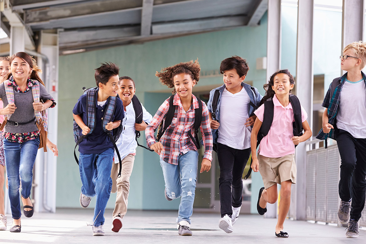 Kids running home from school