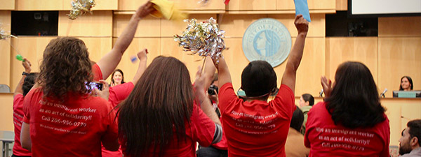 Domestic worker organizers celebrate victory at the City Council offices
