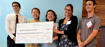 YGB members give a check to Seattle Veterinary