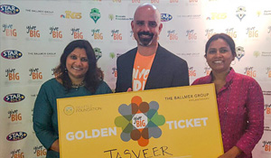 tony holding givebig golden ticket with tasveer members