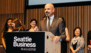 Tony Mestres accepts the Nonprofit of the Year award at Seattle Business Magazine's 2018 Community Impact Awards.