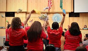 Domestic worker organizers celebrate at the council