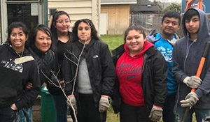 Duwamish River Corps plant a tree for a neighbor