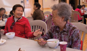 Participants enjoy social time, conversation and a healthy meal through ICHS' community kitchen events