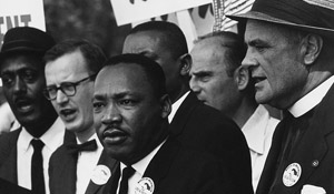 Dr. Martin Luther King Jr. surrounded by supporters during the March on Washington.