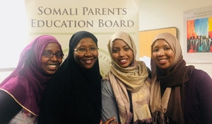 Four members of the Somali Parent Education Board gather.