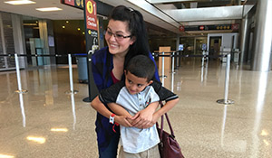 A mother and her son are reunited at SeaTac airport after being separated at the U.S. border