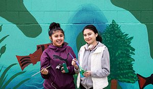 Friends Deysi Olivera, left, and Elisa Antonio, appreciate the 10- week Youth Corps program that increases their understanding of environmental issues and green careers.
