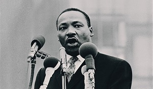 historic image of MLK Jr speaking at event in black and white