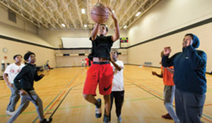 A player goes for a layup at the SeaTac Community Center.