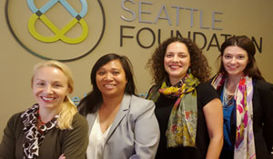 four staff members gathered in front of SeaFdn sign