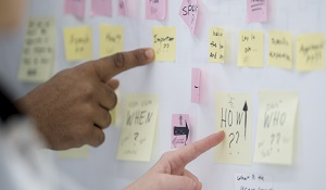 pointing at sticky notes