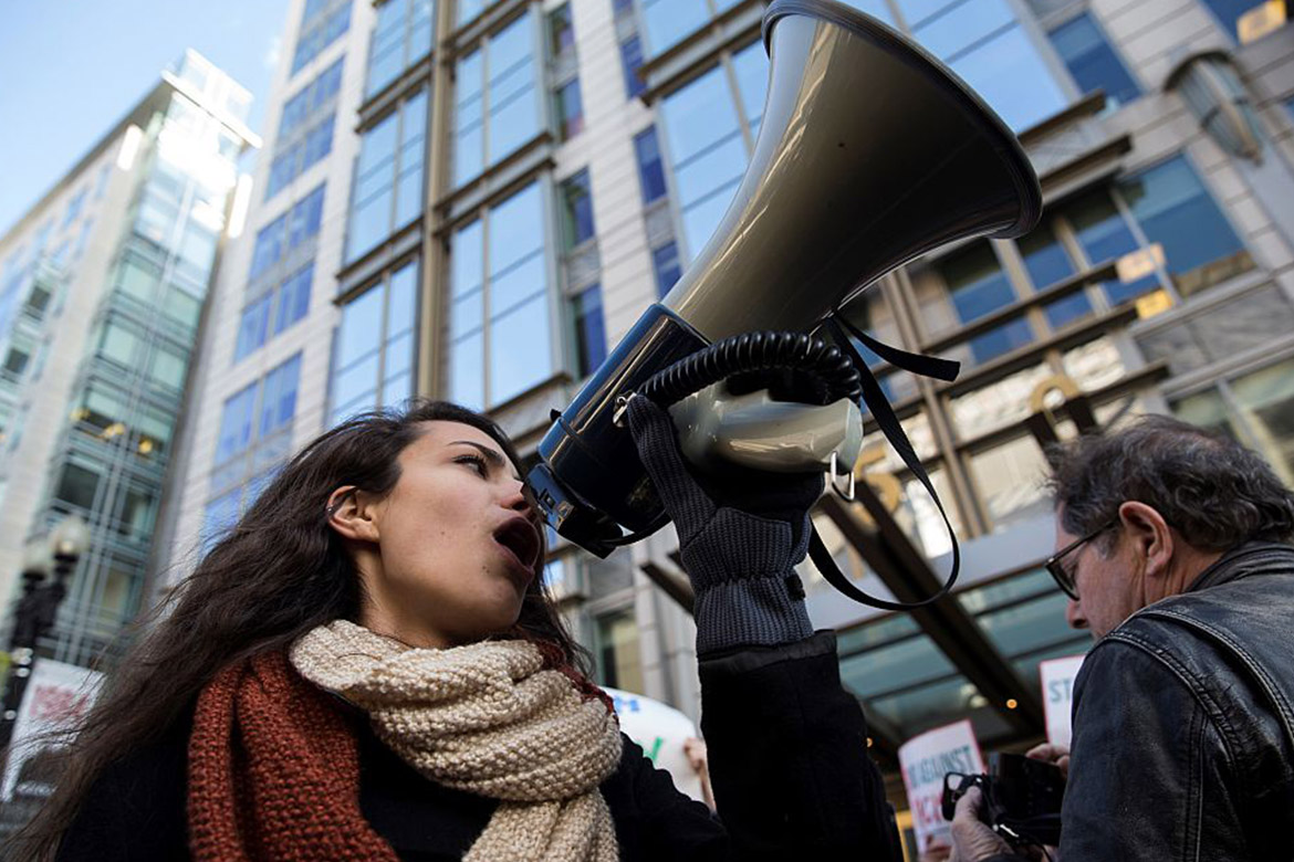 Woman with a megaphone at a protest