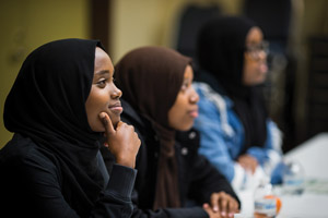 Hajira Nor, foreground, and Hilal Nor, attend a girls' leadership class through Companion Athletics that focuses on career options and more.
