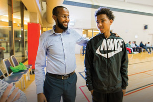 Hassan Wardere, left, one of Companion Athletics' leaders, volunteers a lot of time to mentor and support youth like Nabil Ahmed.
